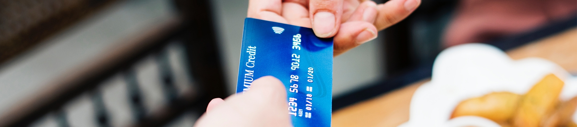 A women handing over a debit card