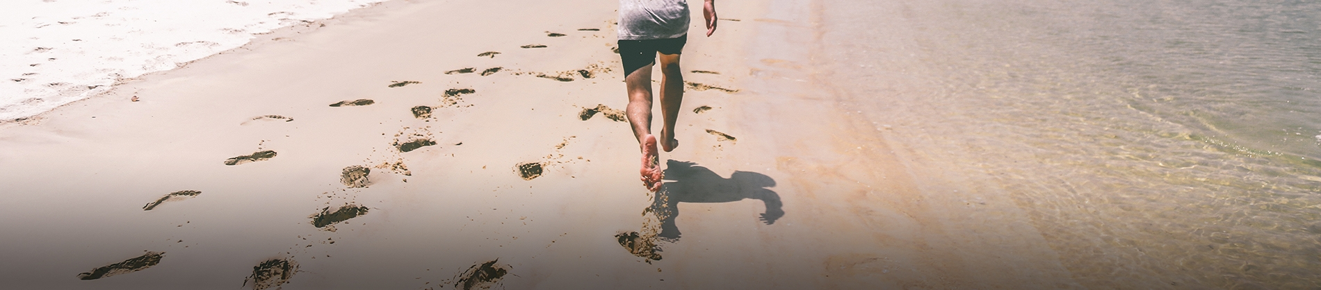 A man running along a beach