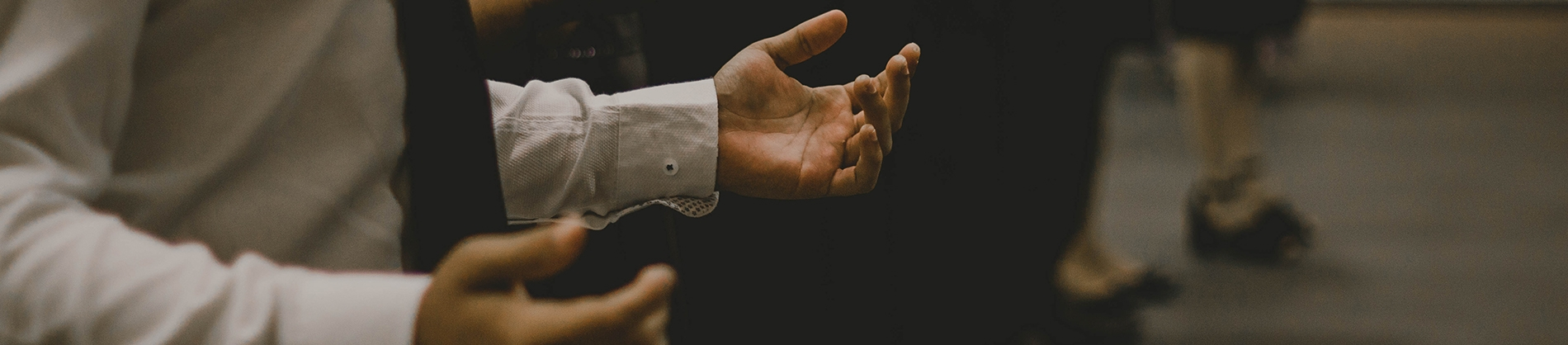 A man with his hands open in worship