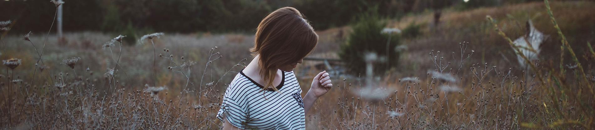 Girl walking through a field