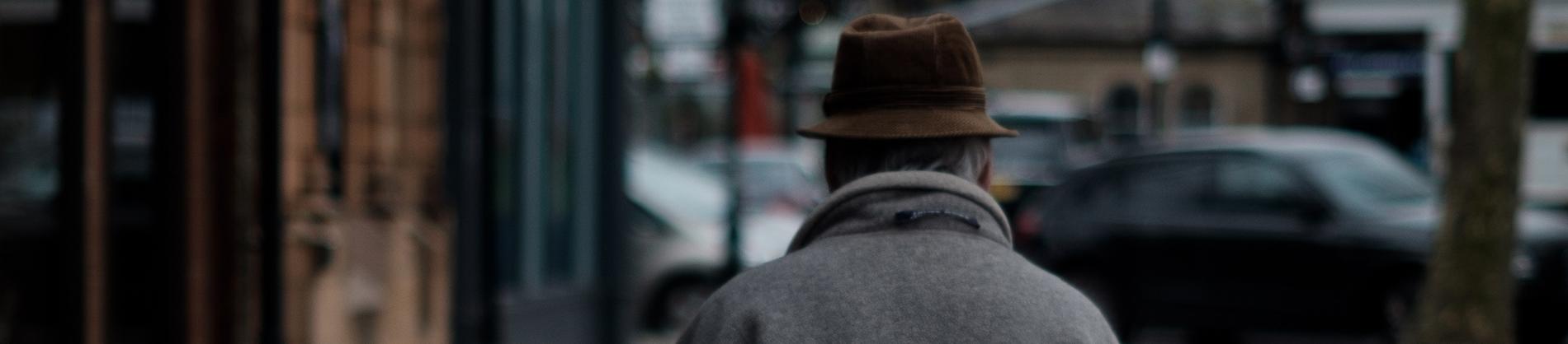 A elderly man walking down the street