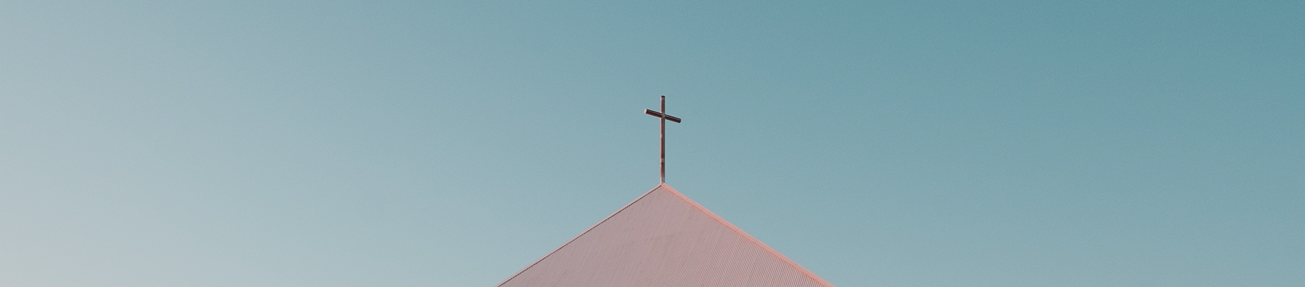 A cross on top of a church building