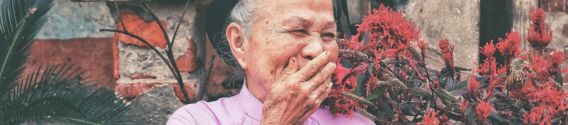 A elderly women laughing
