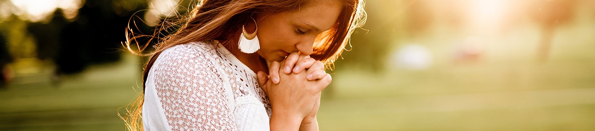 A women with her hands together praying