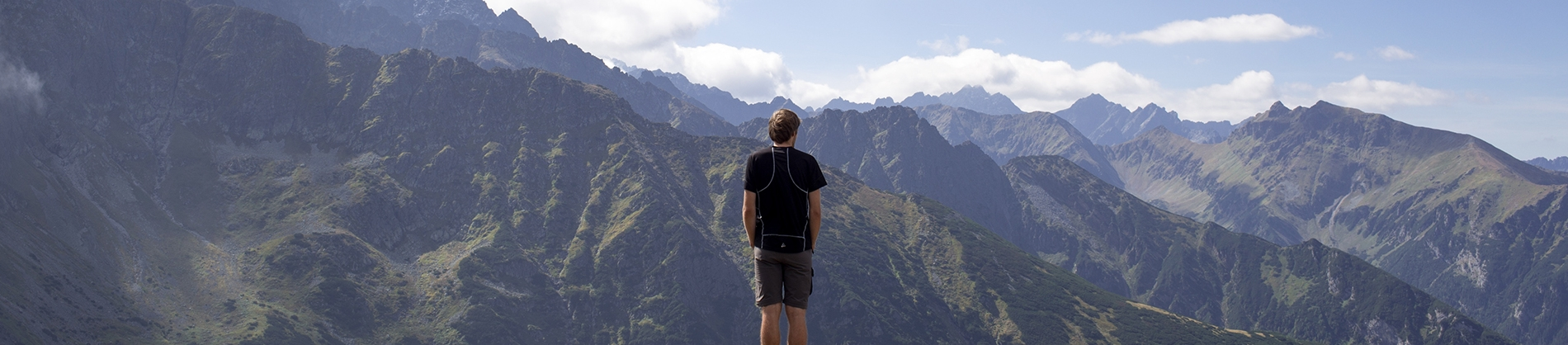 A man looking out over a mountain view