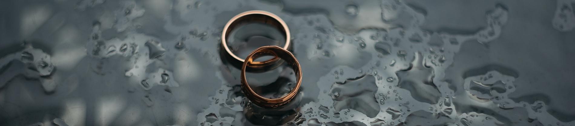 Wedding rings on a rainy floor