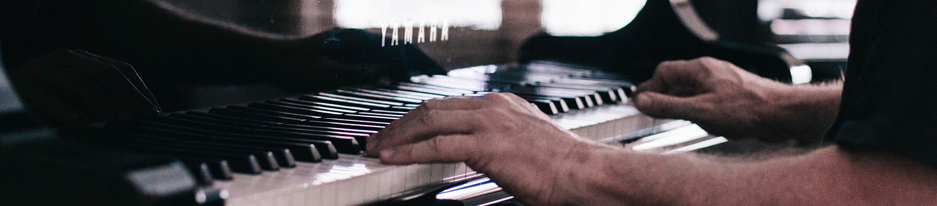 A man sat playing the piano