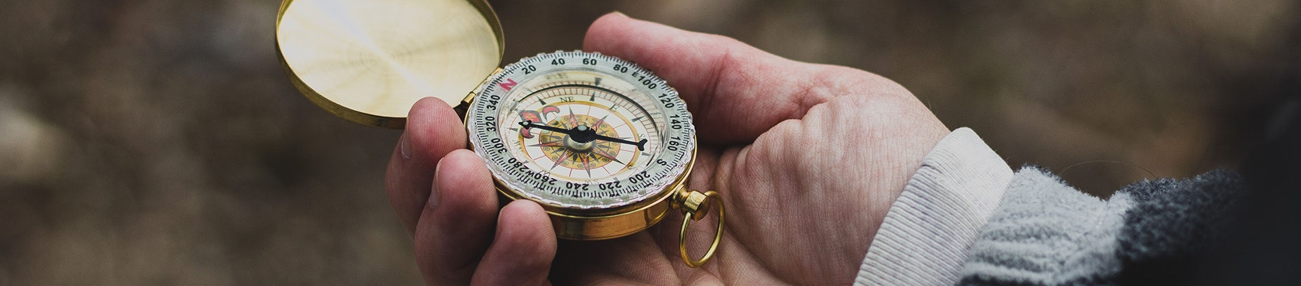A person holding a compass out in front of her