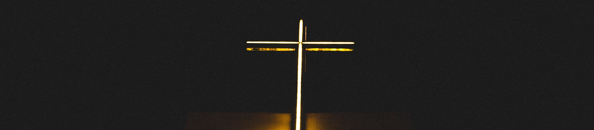 White and yellow lit up cross