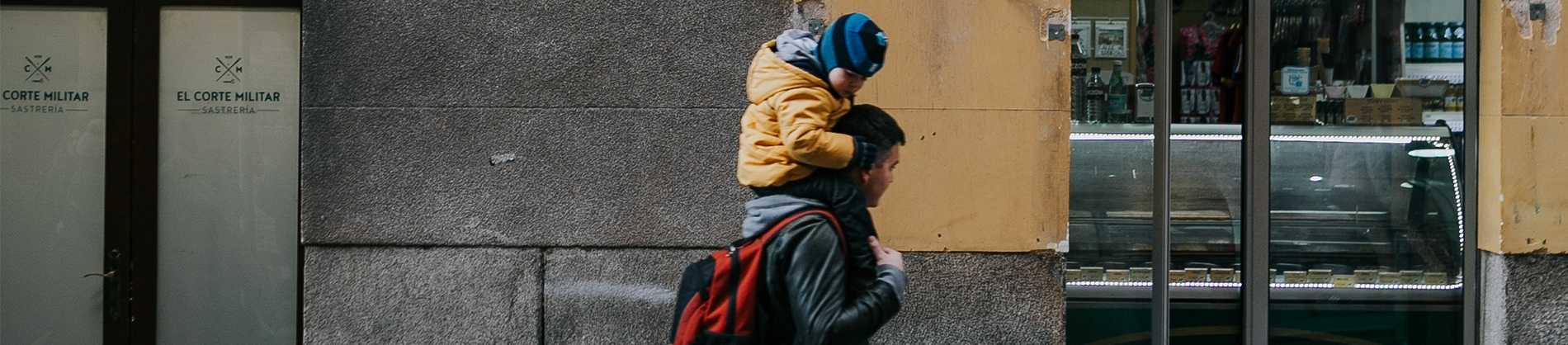A father carrying his child on his shoulders