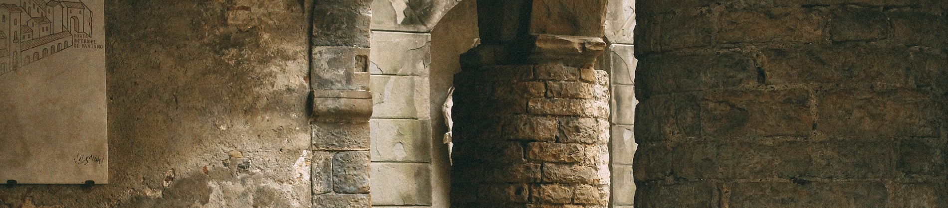 Inside of a church, brick walls and large brick columns