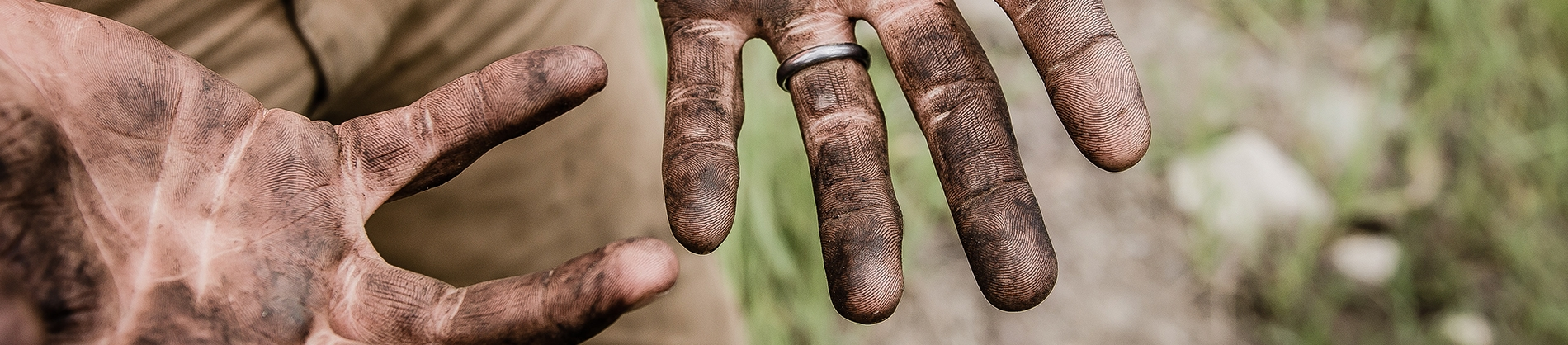 A man with dirt on his hands