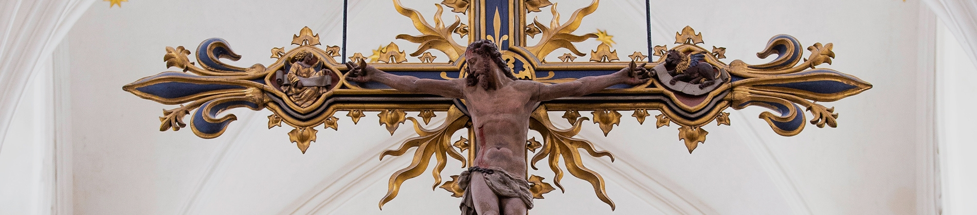 An elaborate statue of Jesus on the cross in a church