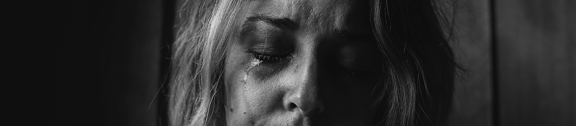A women with tears coming down her face