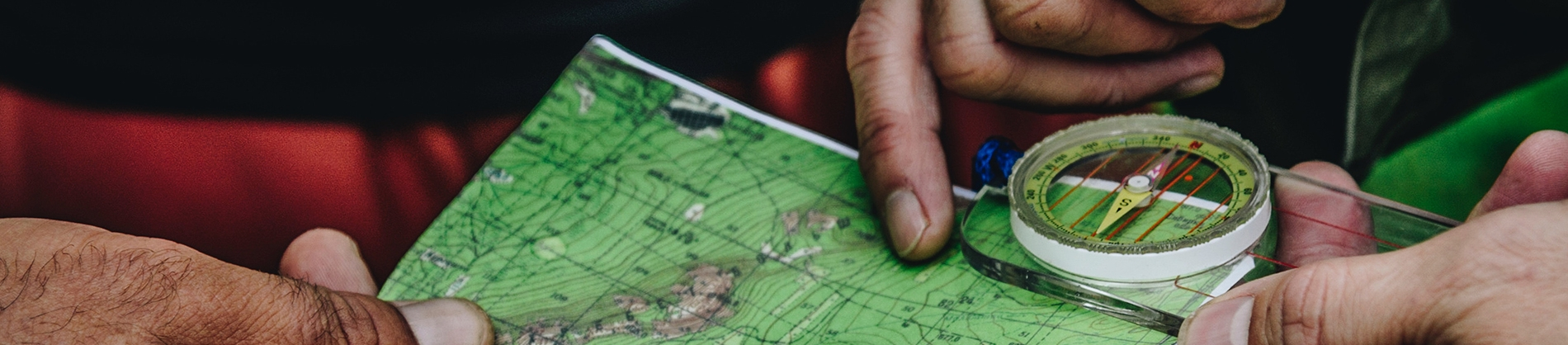 Two people looking at a map and compass