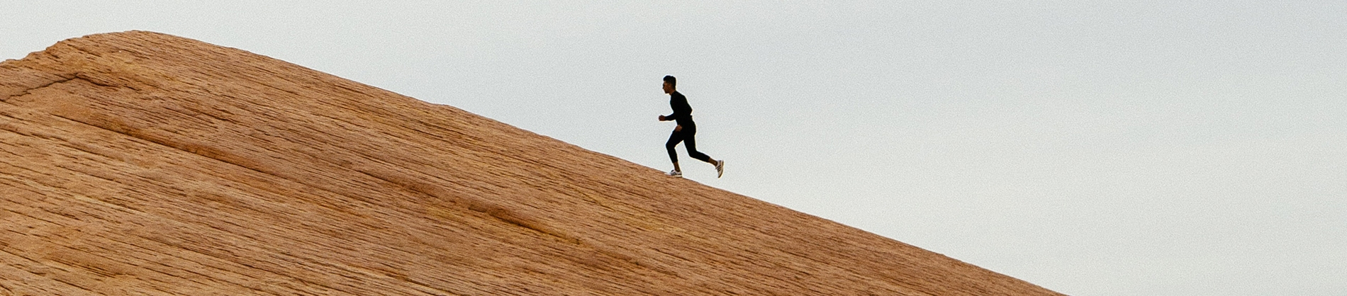 A man running up a rocky hill