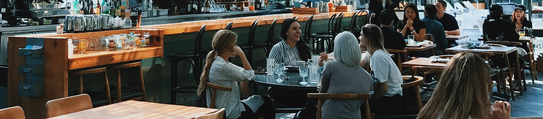 A group of women sat together in a restaurant