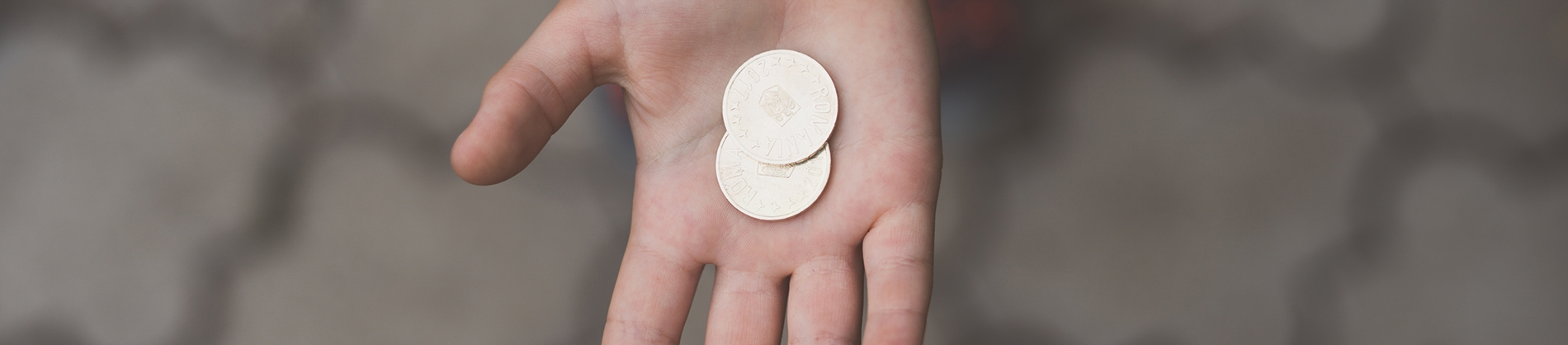 Coins in the palm of someones hand