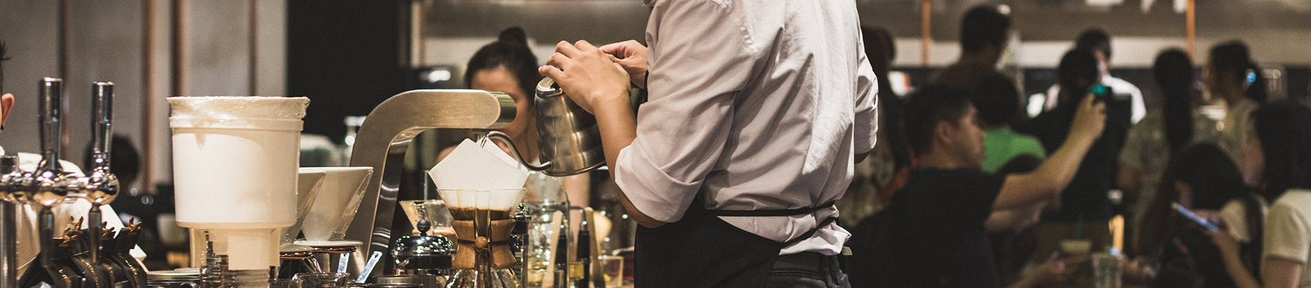 A man serving coffee in a restaurant