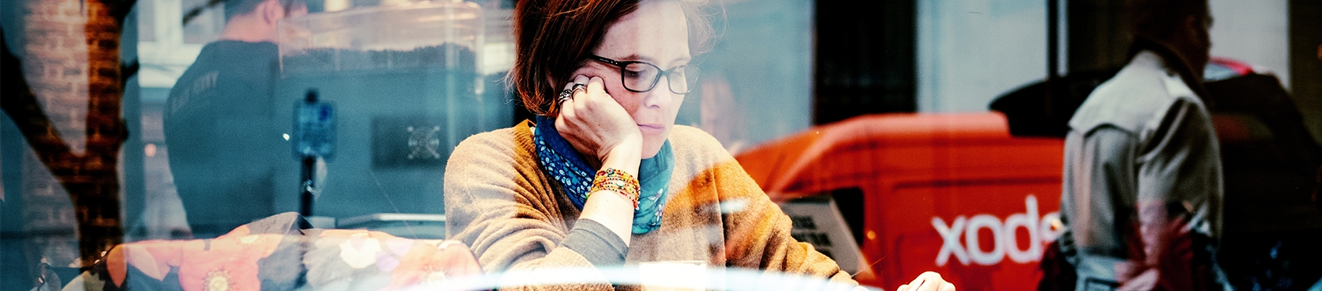 A women sat in a cafe window reading