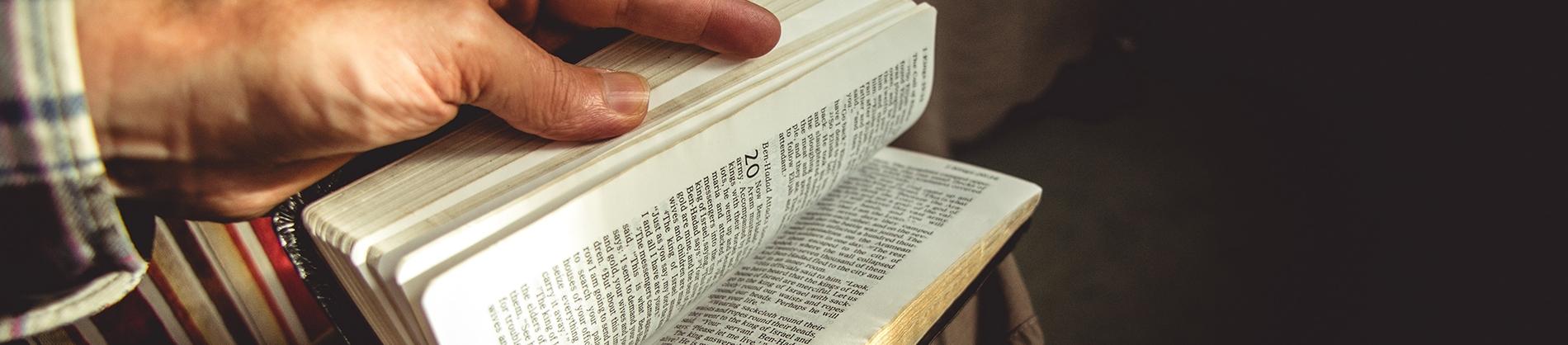 A man opening a bible