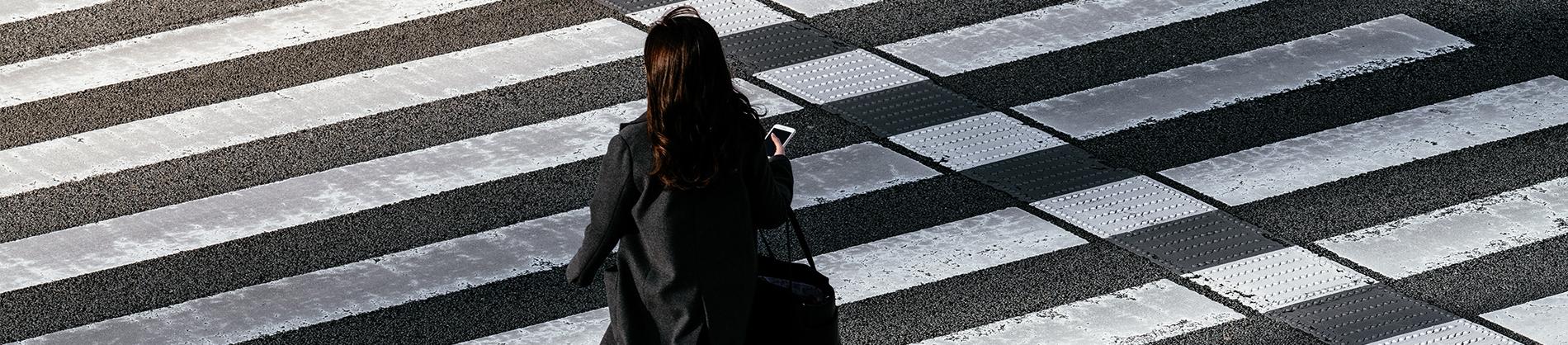 A women crossing a zebra crossing
