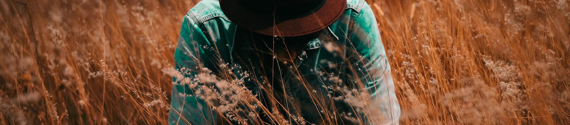 Man knelt down in a field
