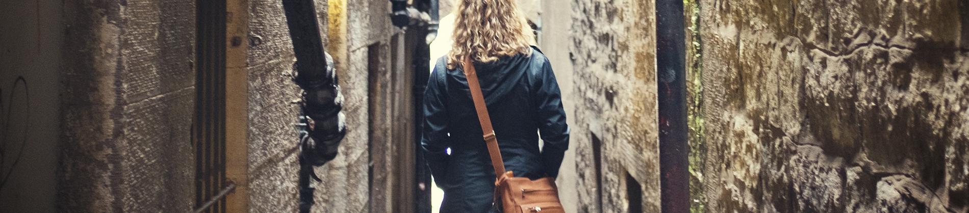 A women walking through an alley way