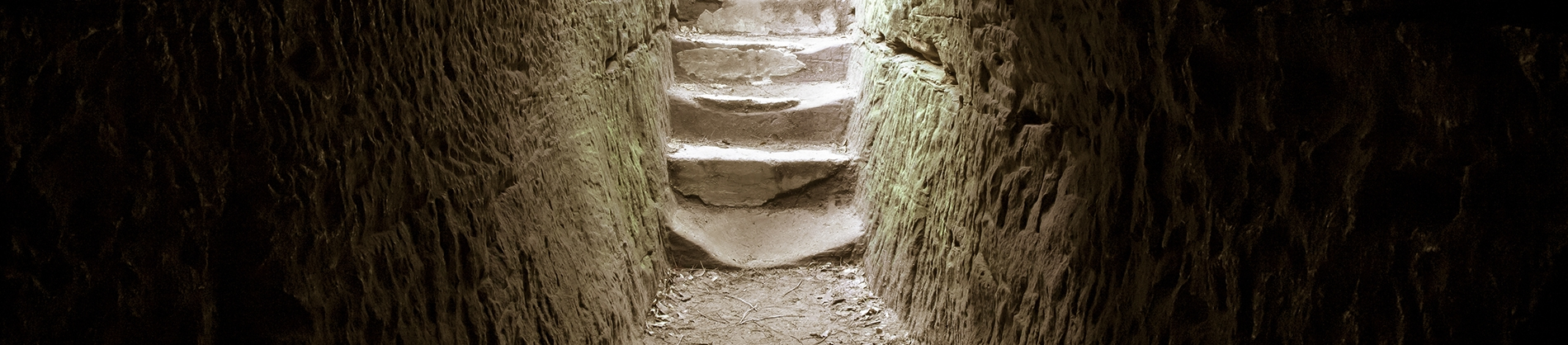 Steps up from inside a tomb into the light