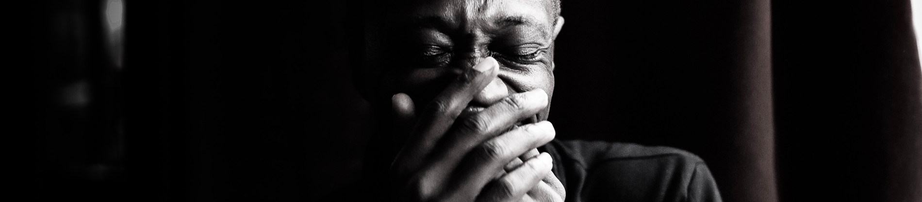 A black and white photo of a man crying