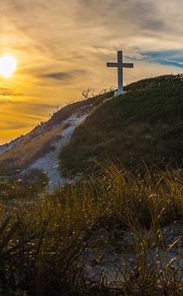 White cross on a hillside