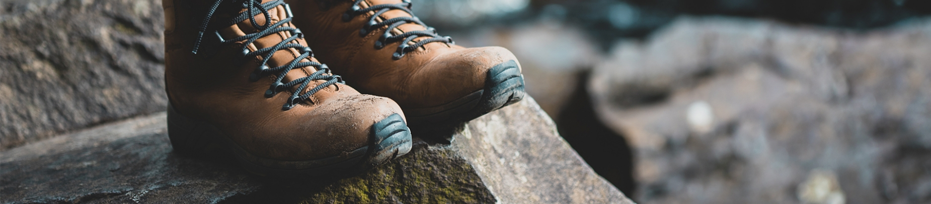 Walking boots on a rock