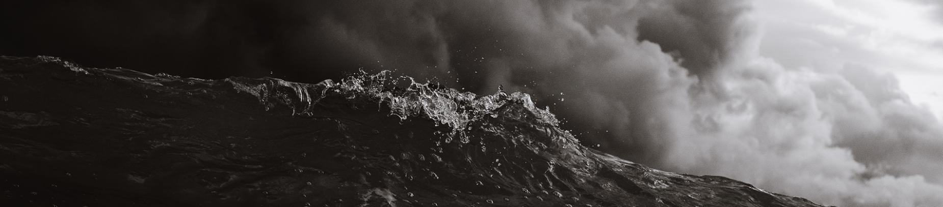 Black and white photo of waves crashing
