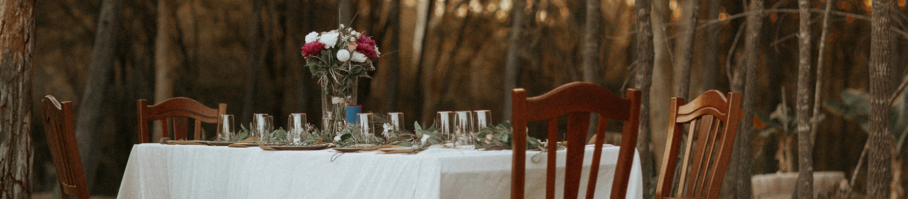 A ornate table set up in a forest