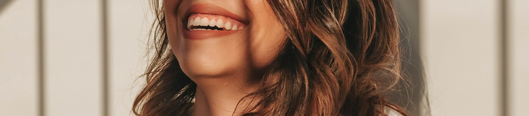 A close up of a women's mouth laughing