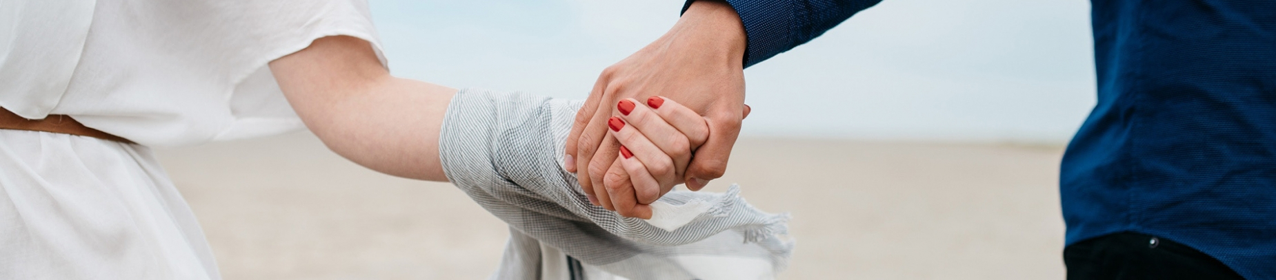 A man and a women holding hands