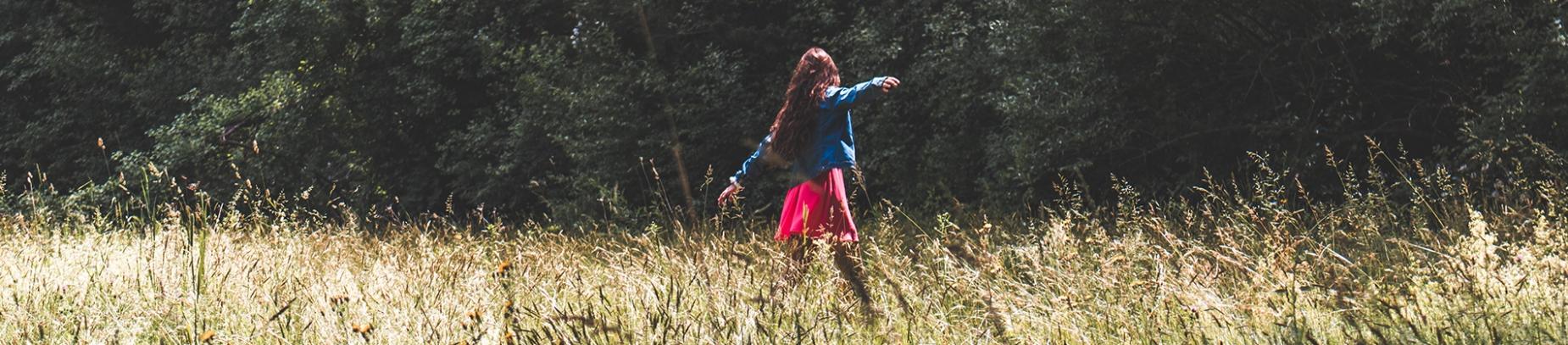 A women dancing in a field