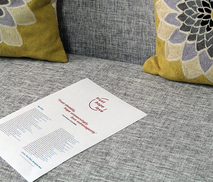 Fathers love letter set on a grey sofa with yellow pillows